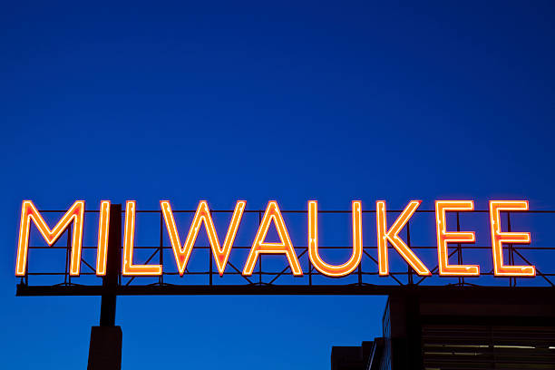Red Milwaukee sign Red Milwaukee sign in downtown of the city. milwaukee wisconsin stock pictures, royalty-free photos & images