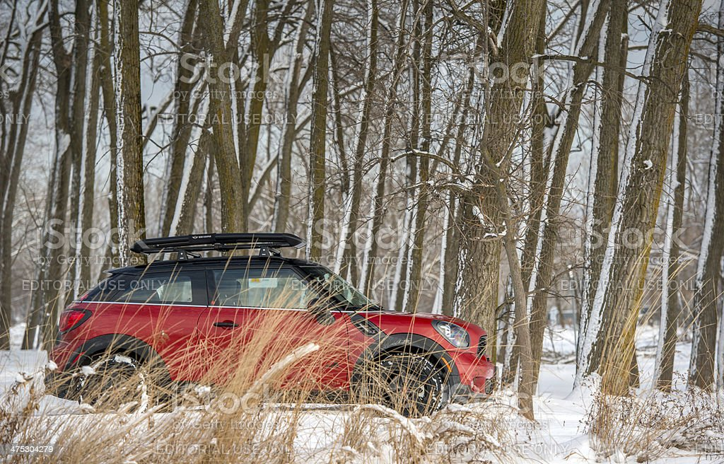 Red MINI COOPER Paceman in the snow stock photo