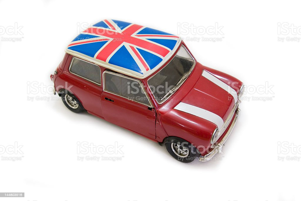 Red Mini Cooper seen from above with a UK flag on the roof stock photo