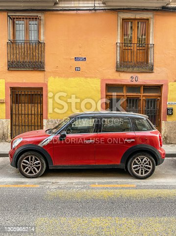 Valencia, Spain - March 6, 2021: Red Mini Countryman car parked in the street. This is a subcompact luxury crossover SUV, the first vehicle of this type to be launched by BMW under the Mini marque in 2010