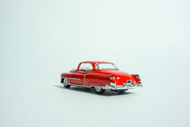 Red miniature classic car. white background stock photo