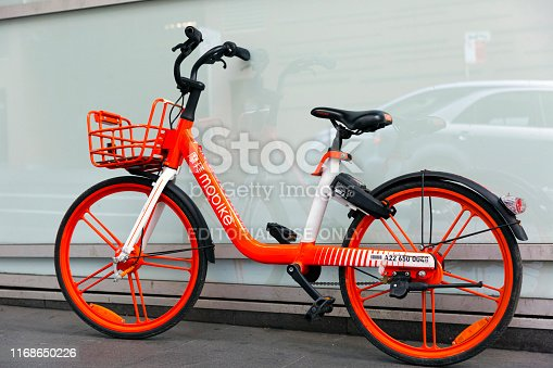 istock Red Mobike in Sydney street, background with copy space 1168650226