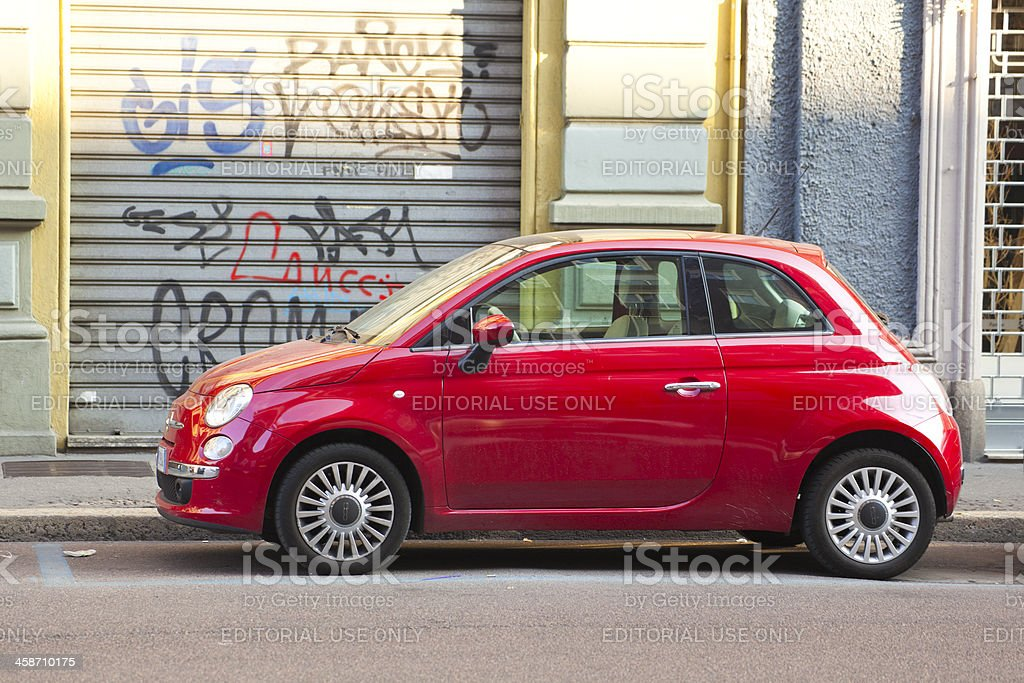Red modern Fiat 500 on a street in Italy stock photo