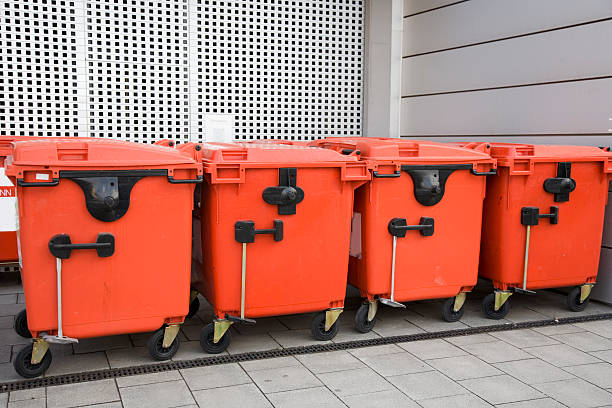red modern trash containers in a row XL stock photo