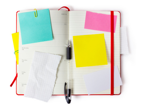 red notebook  or calendar or organizer with precise clipping path
