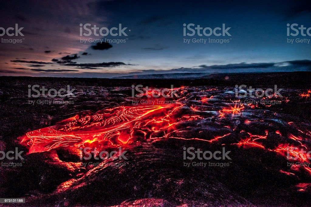 Red molten lava flow from Kilauea volcano stock photo