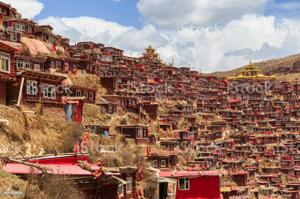 Red monastery and home at Larung gar (Buddhist Academy) in sunshine day and background is blue sky, Sichuan, China. stock photo