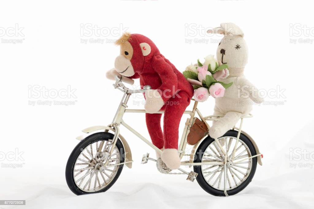Red monkey doll with white rabbit doll  , on a white background. stock photo