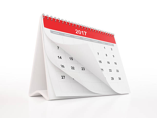 Red Monthly Desktop Calendar: 2017 A general 2017 monthly calendar with curled pages. 2017 calendar is red in colour and standing on a white reflective background. Isolated on white. Clipping path for 2017 calendar is included. Perspective view. Horizontal composition with copy space. 2017 stock pictures, royalty-free photos & images