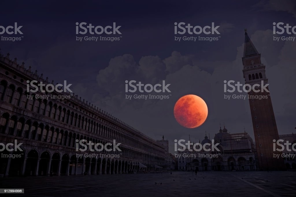 Red moon in blue hour over Venice Italy stock photo