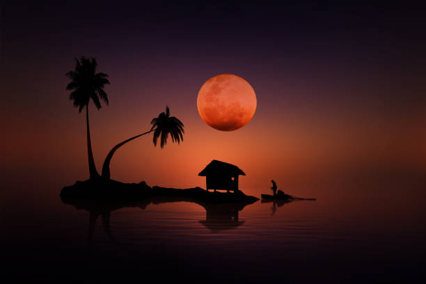 Red moon on the small island stock photo