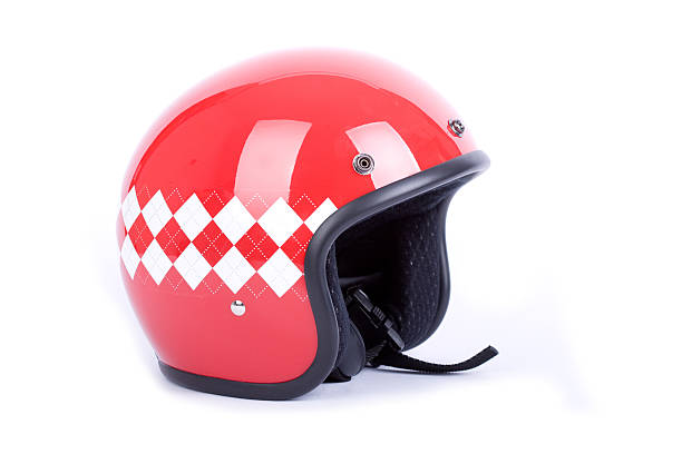 red motorcycle helmet with a white and red diamond pattern - crash helmet stock photos and pictures