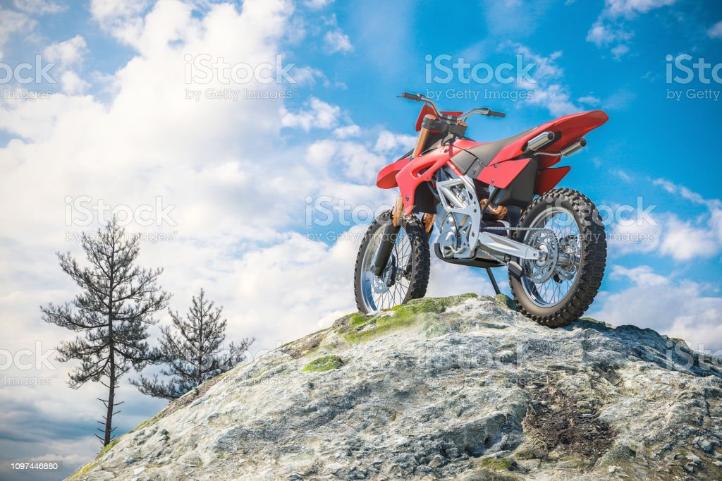 Red motorcycle on top of mountain landscape. stock photo