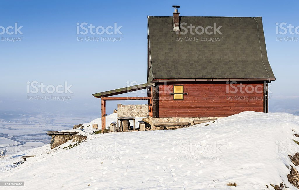 Red mountain cottage on a snow top stock photo