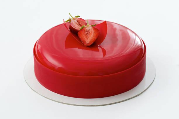 red mousse cake on white background - hausgemachte hochzeitstorten stock-fotos und bilder