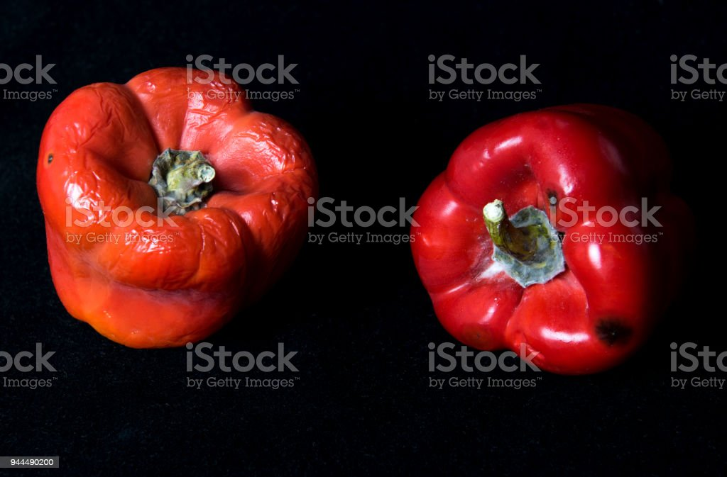 Red moyldy pepper on a black background stock photo