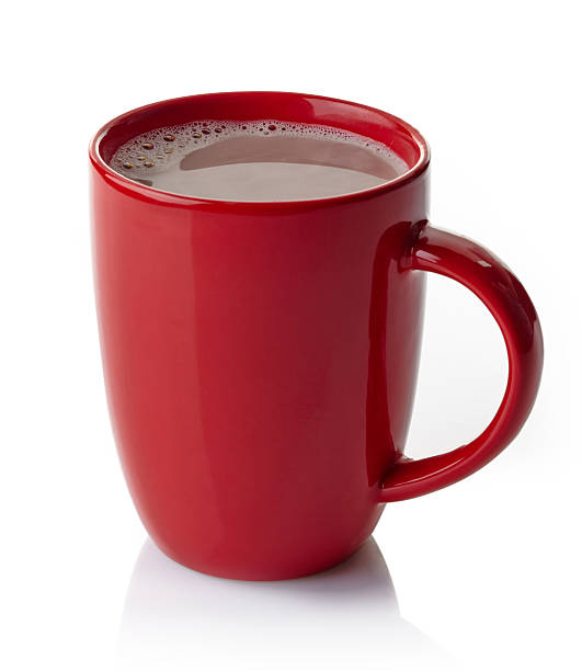 red mug filled with hot chocolate on white background - hot chocolate stock photos and pictures