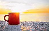 istock Red mug on sunrise 1283853894