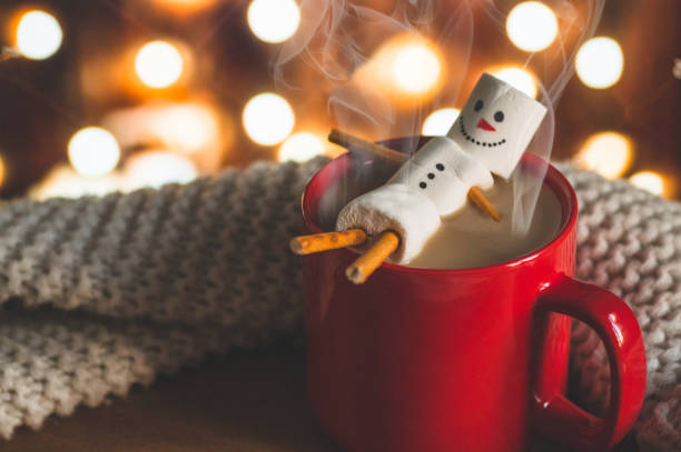 red mug with hot chocolate with melted marshmallow snowman - cioccolata foto e immagini stock