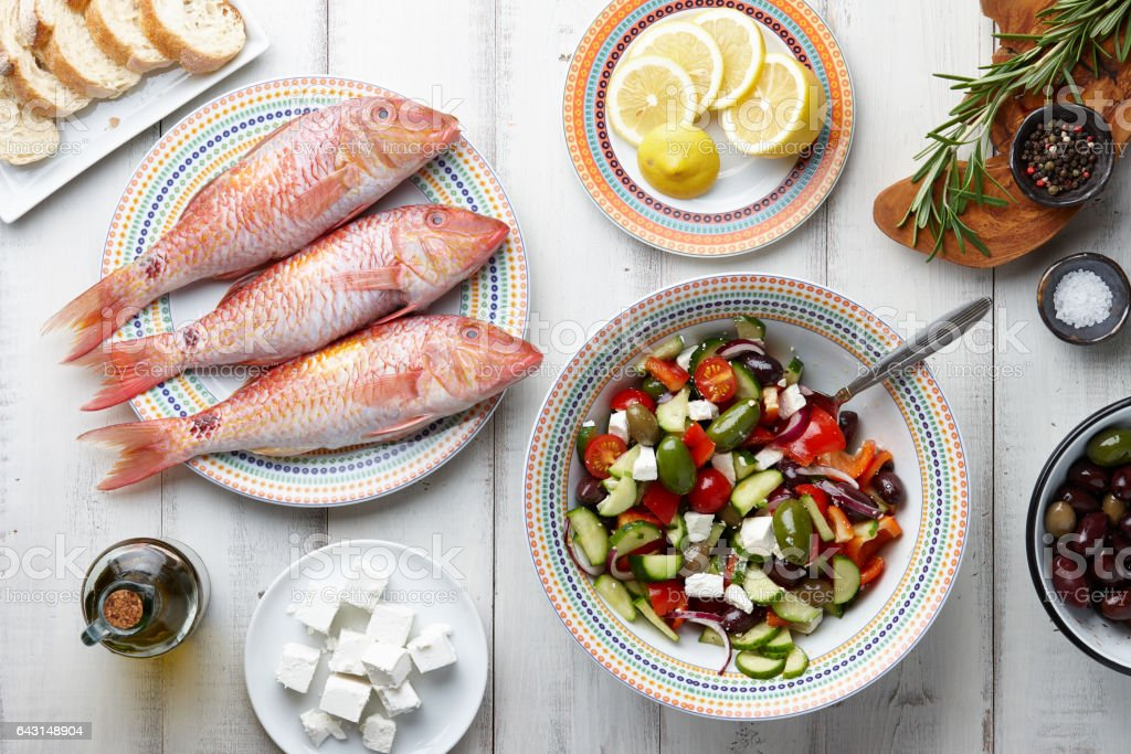 Red mullet fish and mediterranean dishes cooking stock photo