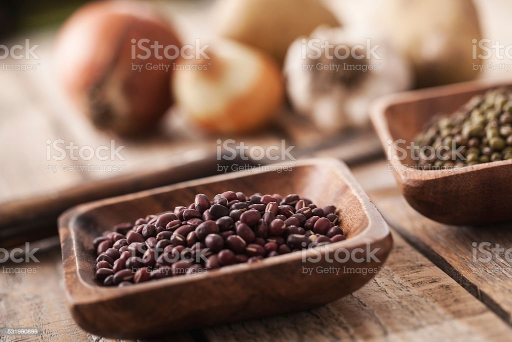 Red Mung bean in wooden bowls stock photo