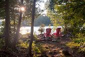 istock Red muskoka chairs at Bruce Peninsula National Park, Tobermory, Canada 1271408679