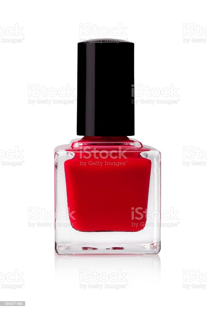 Red nail polish in a glass jar stock photo