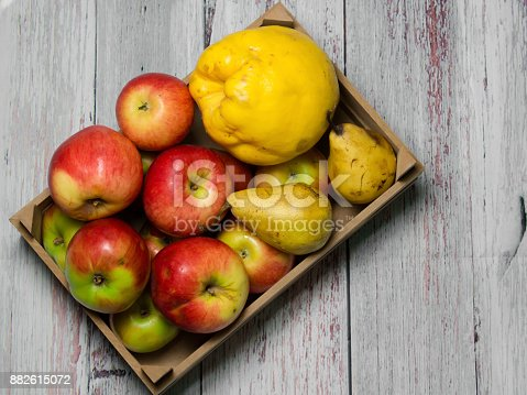 istock red natural fresh apple, quince and pear in wooden case 882615072