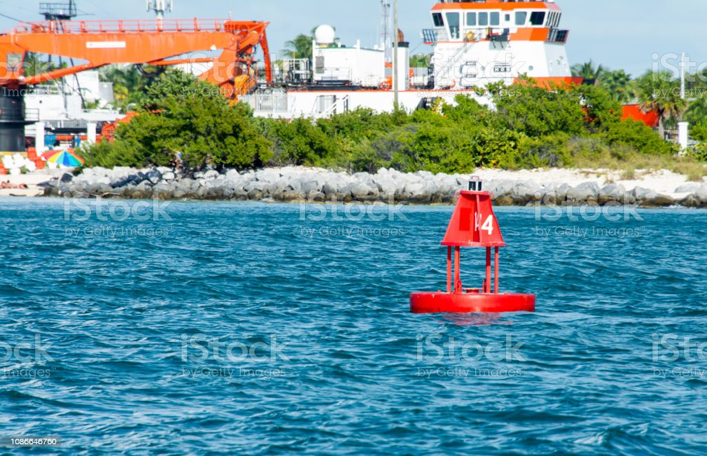 red navigation marker in key west harbor stock photo