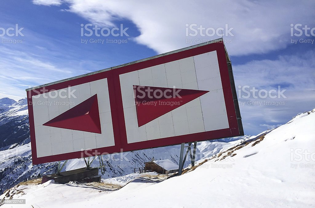 Red navigation sign in the Alps royalty-free stock photo