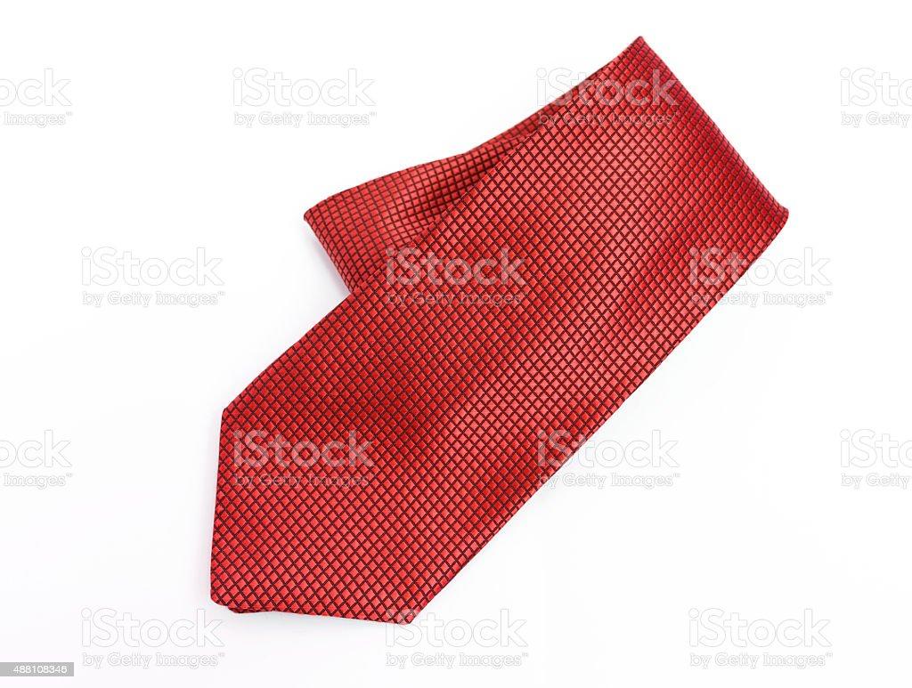 Red necktie on white background stock photo