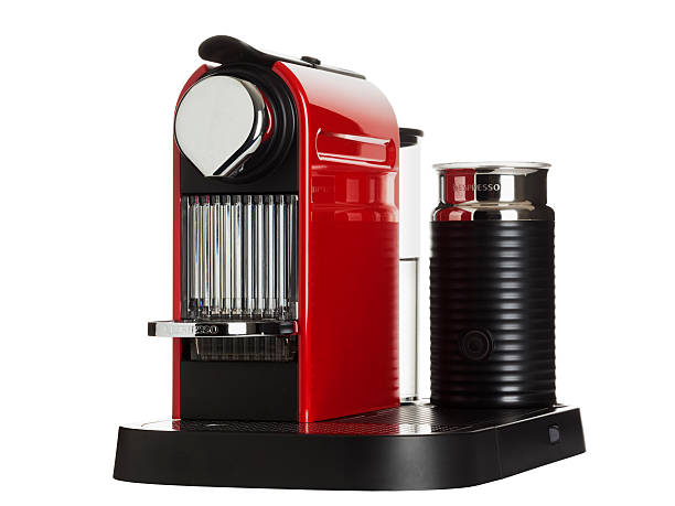 red Nespresso machine isolated stock photo