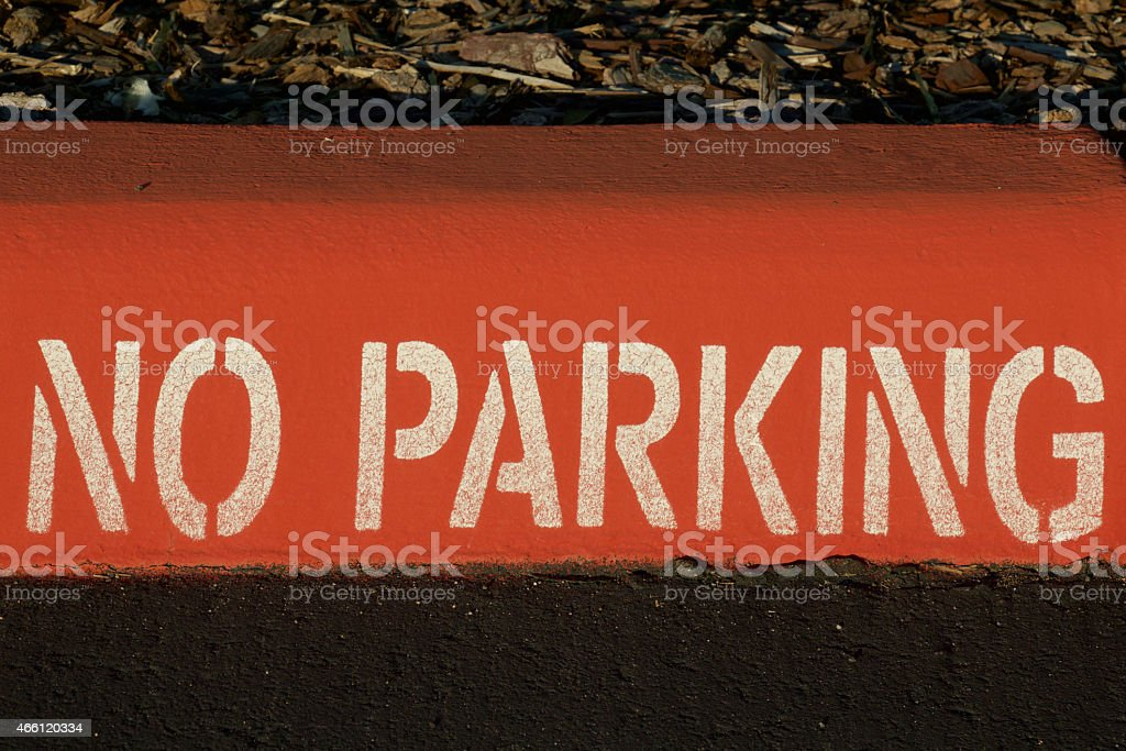 Red No Parking Curb stock photo