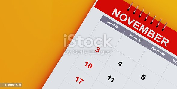 Red November 2019 calendar on yellow background. Horizontal composition with copy space. Calendar and reminder concept.