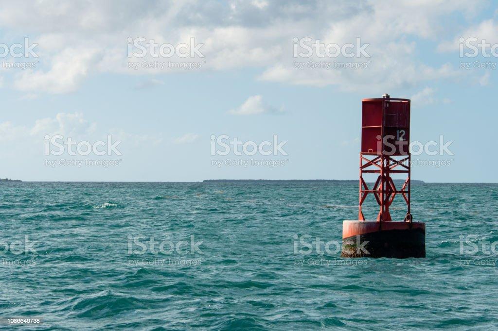 red number 12 navigation marker stock photo