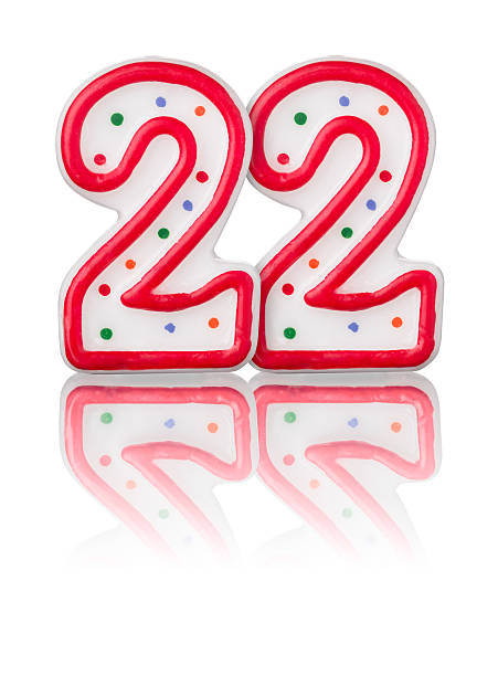 Red number 22 with reflection on a white background stock photo
