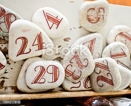 istock red numbers drawn on white stones 1054217916