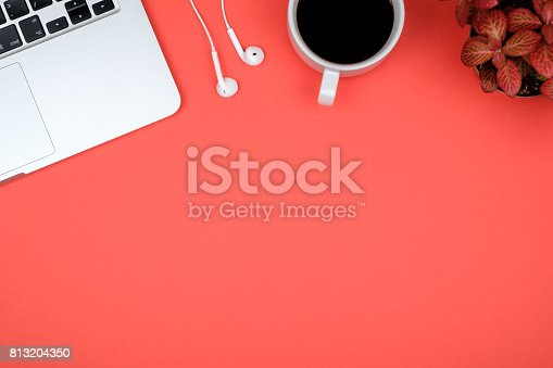 istock Red office desk table with computer. Top view with copy space 813204350