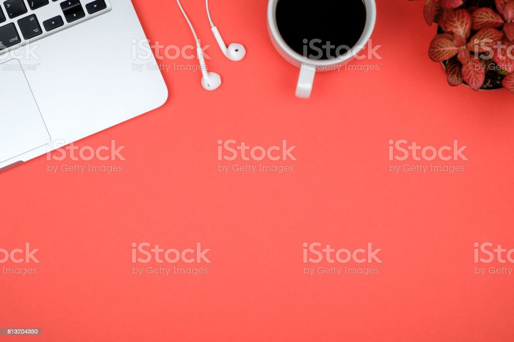 Red office desk table with computer. Top view with copy space stock photo