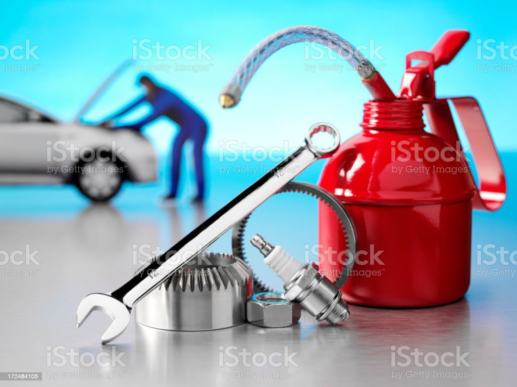 Red Oil Can with a Mechanic, Nuts and Bolts royalty-free stock photo