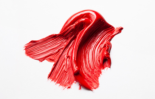 Red oil paint brush stroke, isolated on white background.