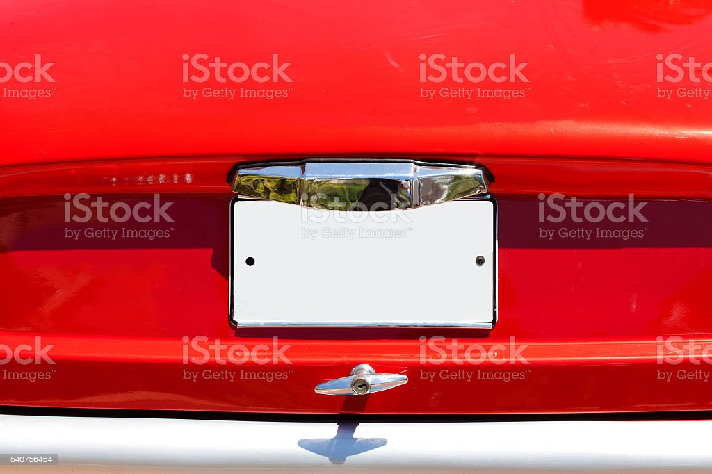 Red old car with empty license plate stock photo