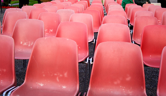 Red old plastic chairs