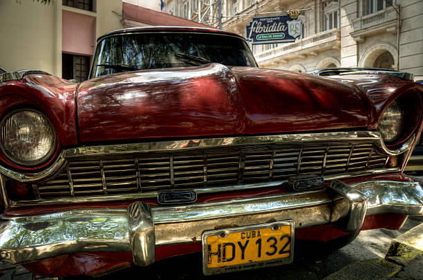 red oldtimer in front of hemingways restaurant el floridita, havana - mahroch stock pictures, royalty-free photos & images