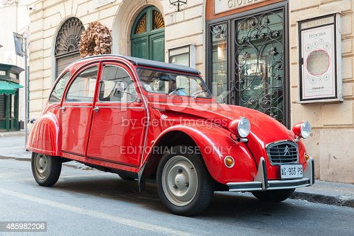 Rome, Italy - August 9, 2015: Red oltimer Citroen 2cv6 Special car stands parked on the city roadside