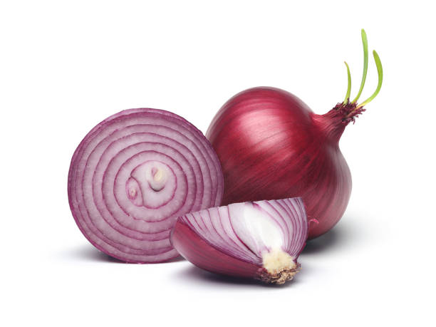 red onion and slices with green sprout - cipolla foto e immagini stock