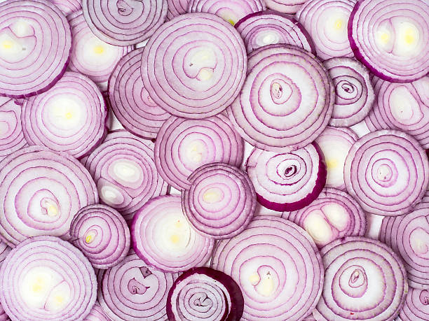Red onion background Background photo of sliced red onions. spanish onion stock pictures, royalty-free photos & images