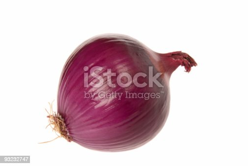 A beautiful red onion isolated on a white background.