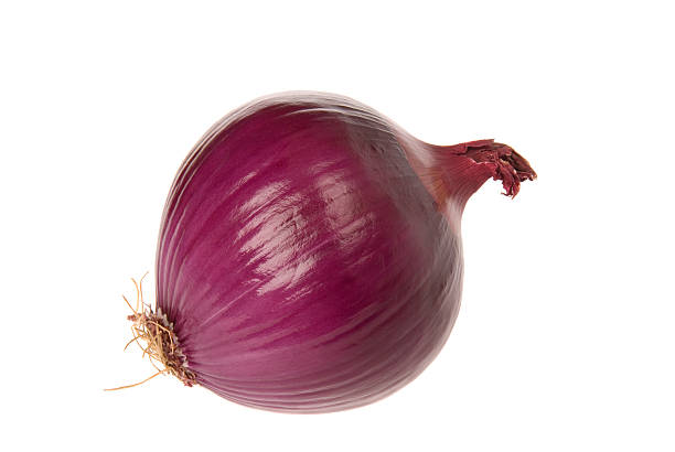 A red onion on a white background