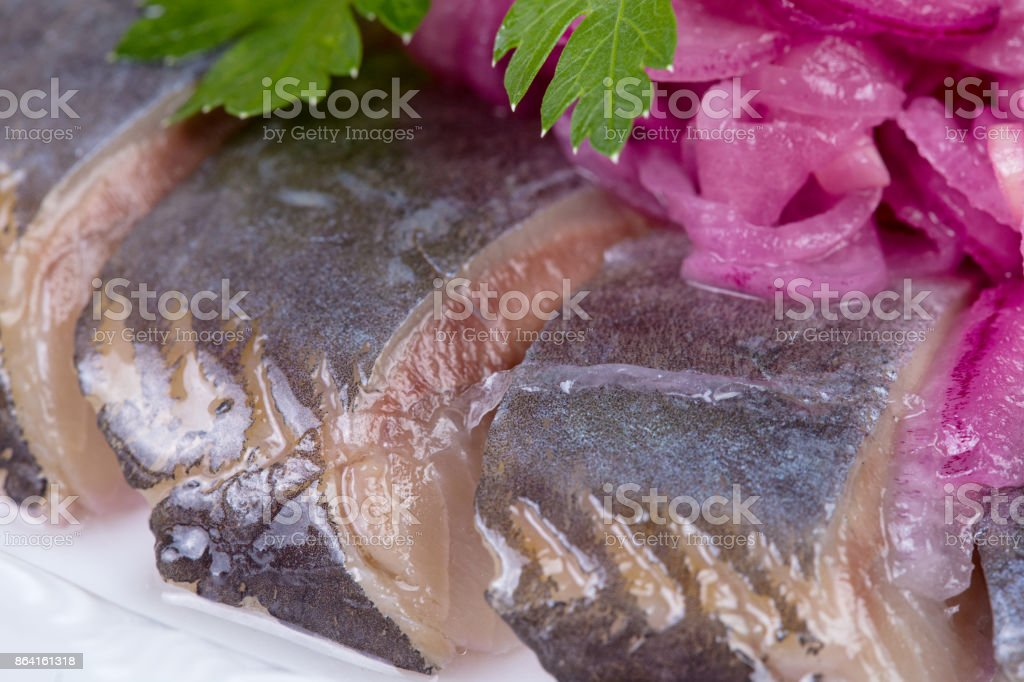 Red onion, parsley with salted herring royalty-free stock photo